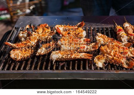 Freshly grilled giant lobsters. Lobster food festival. Lobster bbq.