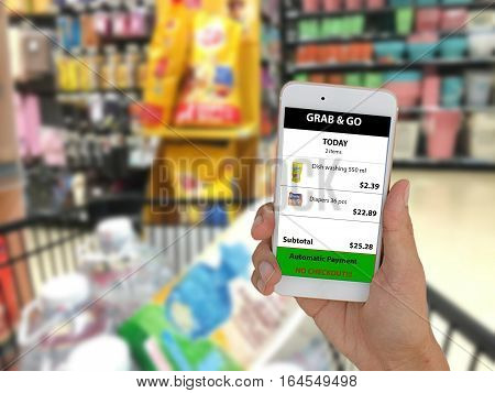internet of things marketting concepts,customer use application in mobile phone to buy a product in retail by grab and go,no checkout,no lines,and automatic payment when exit ,pay by credit