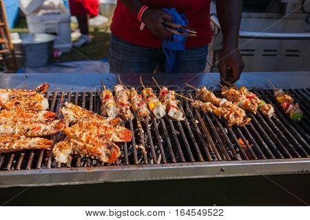 Grilling lobster over hot flame. Lobster food festival. Lobster bbq.