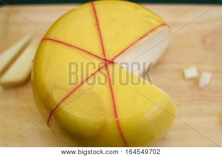 Fresh cheese in pac-man shape on the board