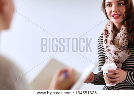 Portrait of happy brunette with mug in hands .