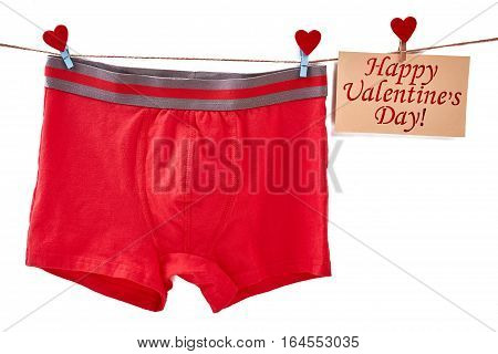 Men's underwear on white backdrop. Valentine's Day card on rope. Useful and simple gift.
