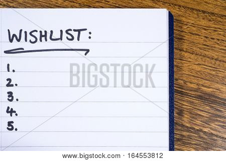 A blank Wish List in a Notebook.