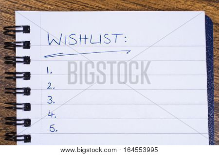 A blank wish list in a Note Book.