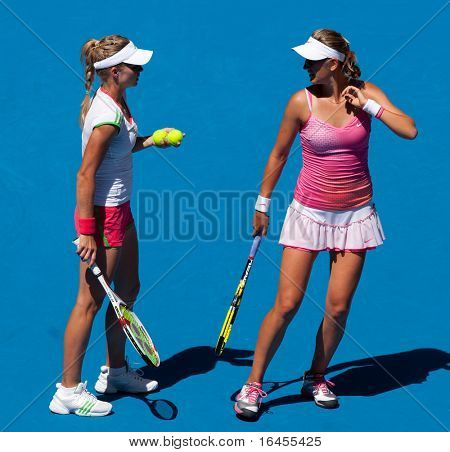 MELBOURNE, AUSTRALIA - JANUARY 28: Maria Kirilenko of Russia (L) with partner Victoria Azarenka of Belarus in the women's doubles final  at the Australian Open on January 28, 2011 in Melbourne, Australia.