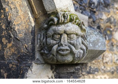 A gargoyle on the exterior of Waltham Abbey Church in Waltham Abbey Essex.