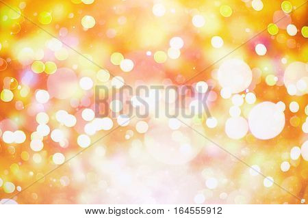 Abstract bokeh background. Christmas Glittering background. Abstract christmas background. Glittering Christmas background. Yellow christmas background Glitter christmas background.