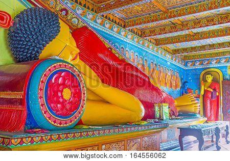 ANURADHAPURA SRI LANKA - NOVEMBER 26 2016: The statue of Buddha reached Nirvana in Isurumuniya Rock Temple on November 11 in Anuradhapura.
