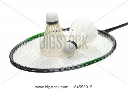 Badminton racquet and two feather shuttlecocks isolated on white