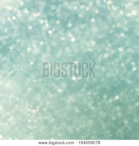 white blue gradient glitter bokeh from fresh snow abstract texture background