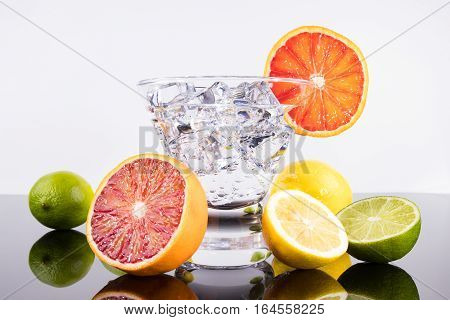 Sparkling Beverage In A Martini Glass With Colorful Citrus