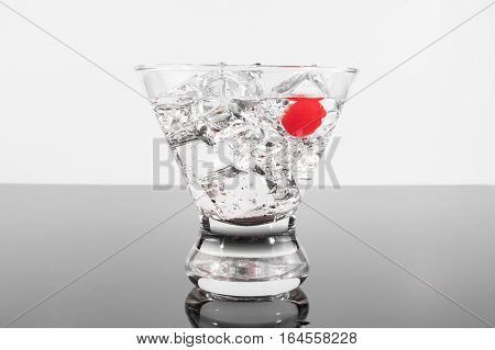 Sparkling Beverage In A Martini Glass With A Cherry