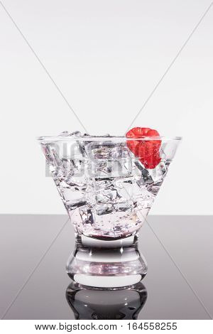 Sparkling Beverage In A Martini Glass With A Raspberry