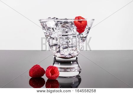 Sparkling Beverage In A Martini Glass With Raspberries