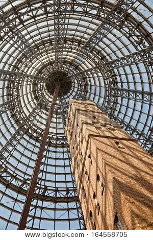 Melbourne Australia - February 2015: Melbourne's Shot Tower which was built on the site in 1888 is an iconic building contained underneath a massive glass dome at the Melbourne Central shopping centre