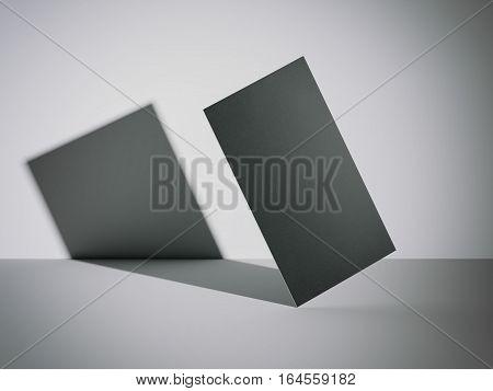 Black business card in a bright modern studio. 3d rendering