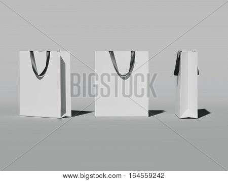 Three white shopping bags in bright studio. 3d rendering