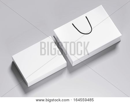 White blank box and shopping bag on a gray floor. 3d rendering