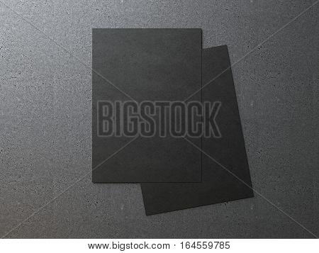 Two black blank paper sheets on a dark floor. 3d rendering