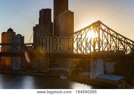Sunset flare, Brisbane Cityscape and Story Bridge silhouette
