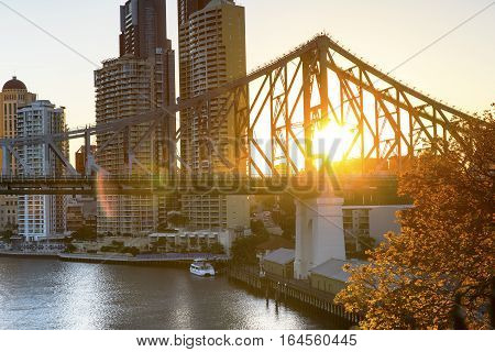 Brisbane cityscape and sunset flare through Brisbane Story bridge