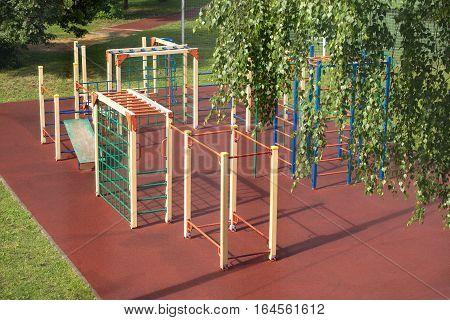 New Children Playground outdoor in summer park after rain