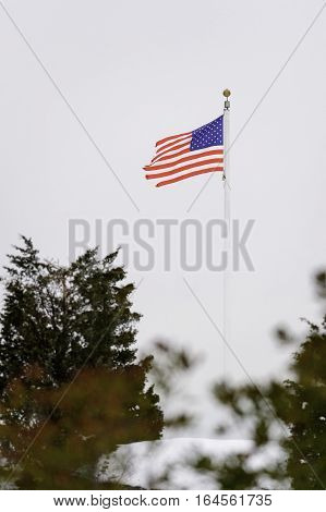 Stiff breezes along Fort Phoenix waterfront inflict wear and tear on American flag