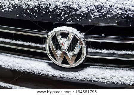 STRASBOURG FRANCE - JAN 20 2016: Volkswagen VW logotype covered with snow flakes. On 18 September 2015 the United States Environmental Protection Agency (EPA) issued a notice of violation of the Clean Air Act to German automaker Volkswagen Group after it