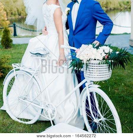 Wedding decoration trends. White bycicle. Photo area.