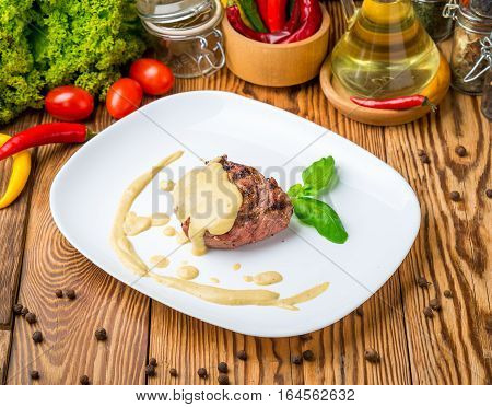 veal steak on a plate with sauce