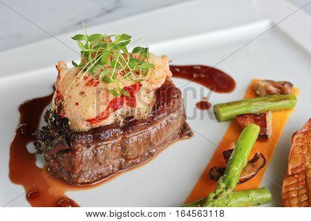 Closeup pan roasted beef tenderloin, lobster medallion