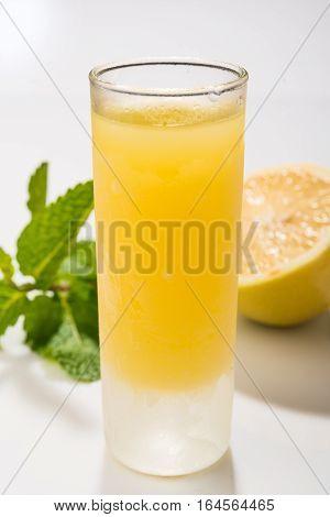 Traditional homemade lemon liqueur limoncello and fresh citrus. Italian traditional liqueur limoncello with lemon. Italian alcoholic beverage.