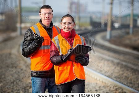 Man and a woman railroad workers maintaing railway