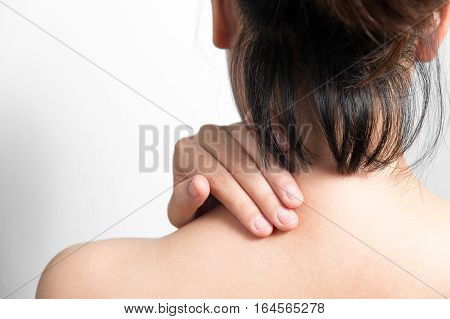 Young woman with pain in her back. Back pain and health concept.