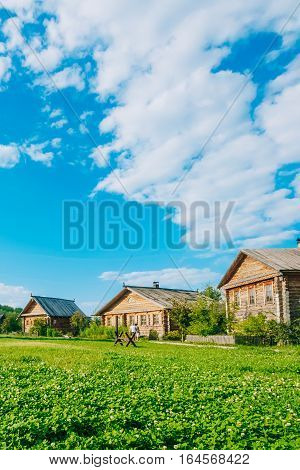 Russian log hut on a background of blue sky with clouds