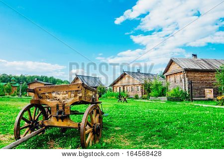 Rural landscape with a cart in the foreground