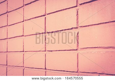 Background of orange brick wall. Retro vintage filter effect.