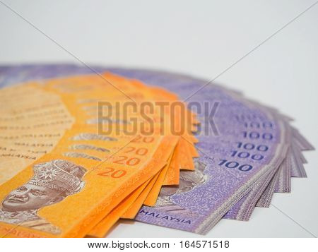 Close Up of Malaysia currency RM 20 and 100 ringgit Banknotes, Finance Concept Selective Focus