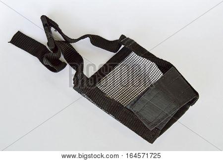 black fabric dog muzzle on white background