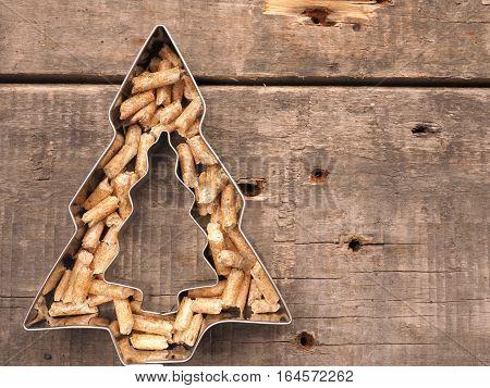 Wooden pellets in tree shape alternative energy concept image
