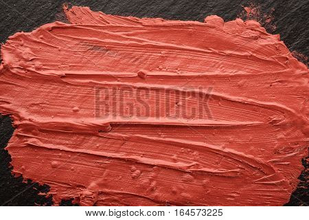 Lipstick, cosmetic product for painting and protection of lips.