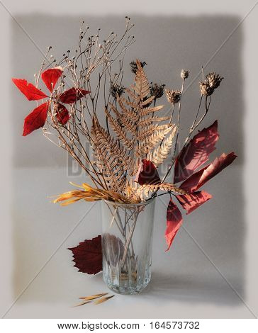 Autumn bunch of leaves and dry plants , modest and beautiful decoration for the interior