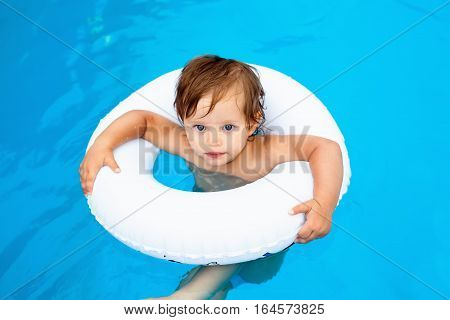 Baby in pool to swimming with a lifeline