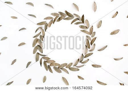 Floral pattern and round frame wreath dried leaves isolated on white background. Flat lay top view