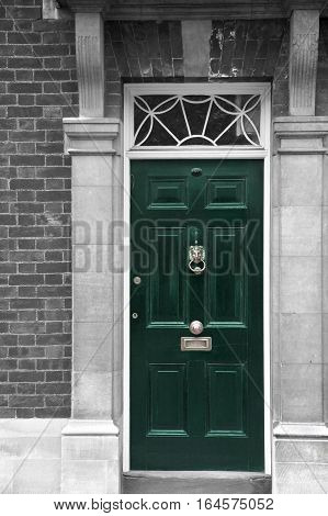 Grand green wooden door part of a building, home or office related. London England