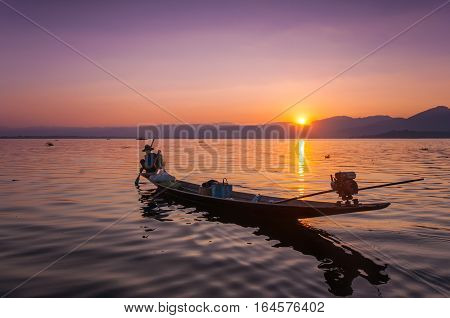 Local fishermen are fishing by boat in Inle lake, Myanmar