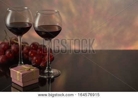 Valentines Day with a glass of red wine grapes gift.