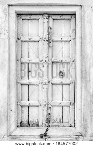 One of the wooden doors leading to the stairs inside one of the minarets at the Taj Mahal.