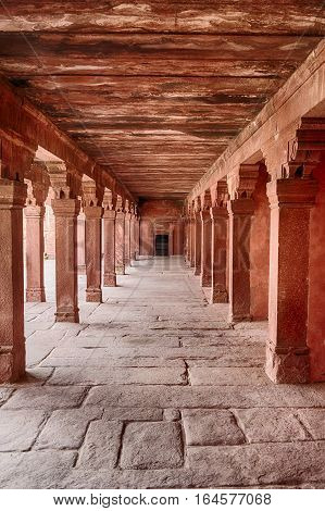 A corridor constructed with red sandstone leads to the entrance to the Emperor's bed chambers in the ancient city of Fatehpur India