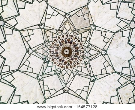 An eight-sided geometric pattern is inlaid into the ceisling of the ceremonial Drum House (Naqqar Khana) of the Red Fort in Delhi India.